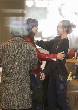 Lily Rose Depp, Vanessa Paradis & Monica Bellucci at airport in Paris