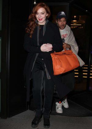 Lindsay Lohan in Black Coat Leaves her hotel in Milan