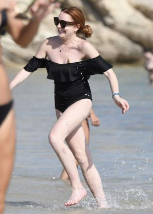 Lindsay Lohan in Black Swimsuit on the beach in Mykonos