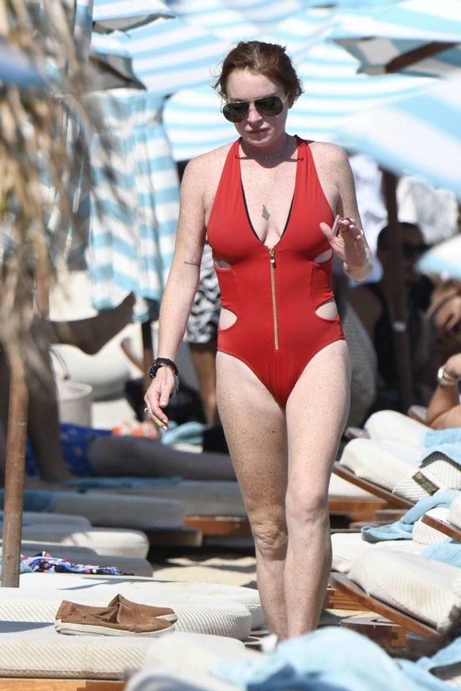 Lindsay Lohan - In Red Sweamwear on the beach in Mykonos