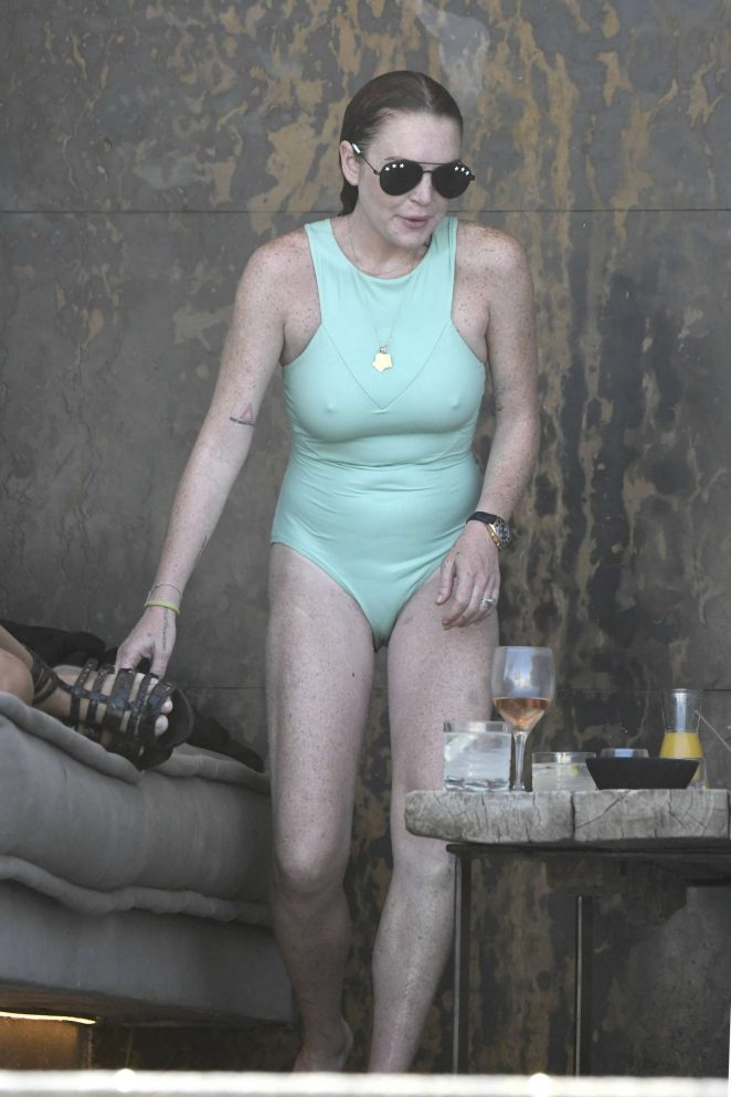 Lindsay Lohan in Swimsuit on the beach in Mykonos