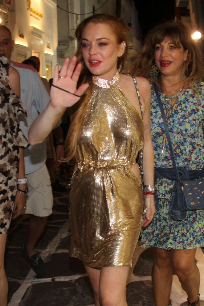 Lindsay Lohan in Gold Mini Dress Night out in Mykonos