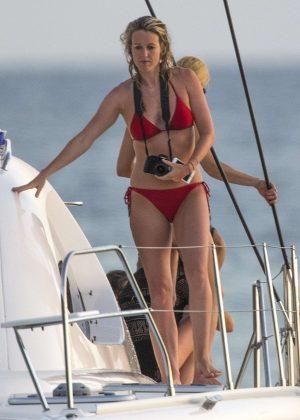 Lisa Carrick in Red Bikini on a boat in Barbados