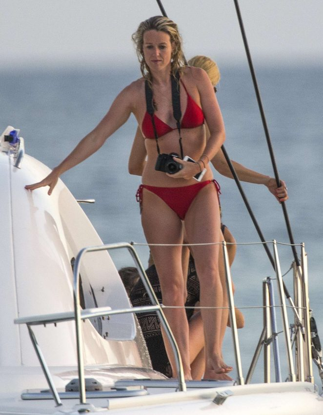 Lisa Carrick in Red Bikini on a boat in Barbados
