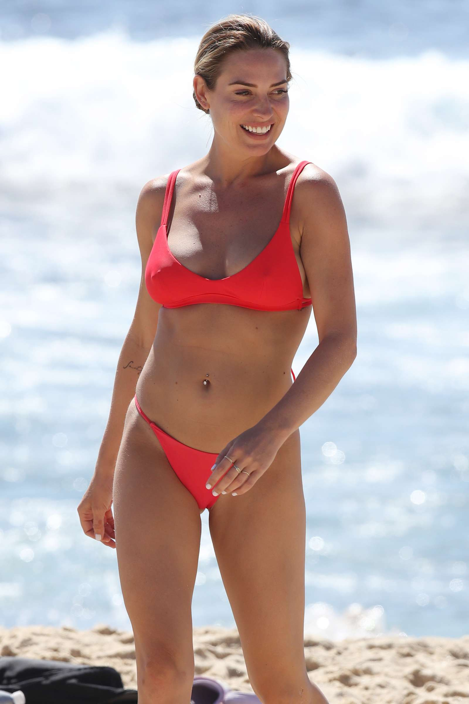 Lisa Clark in Red Bikini on the beach in Sydney