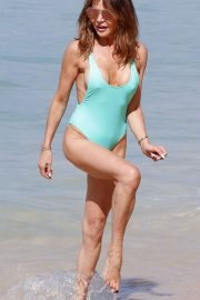 Lizzie Cundy in Blue Swimsuit on the beach in Barbados