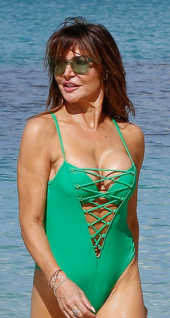 Lizzie Cundy in Green Swimsuit on the beach in Barbados
