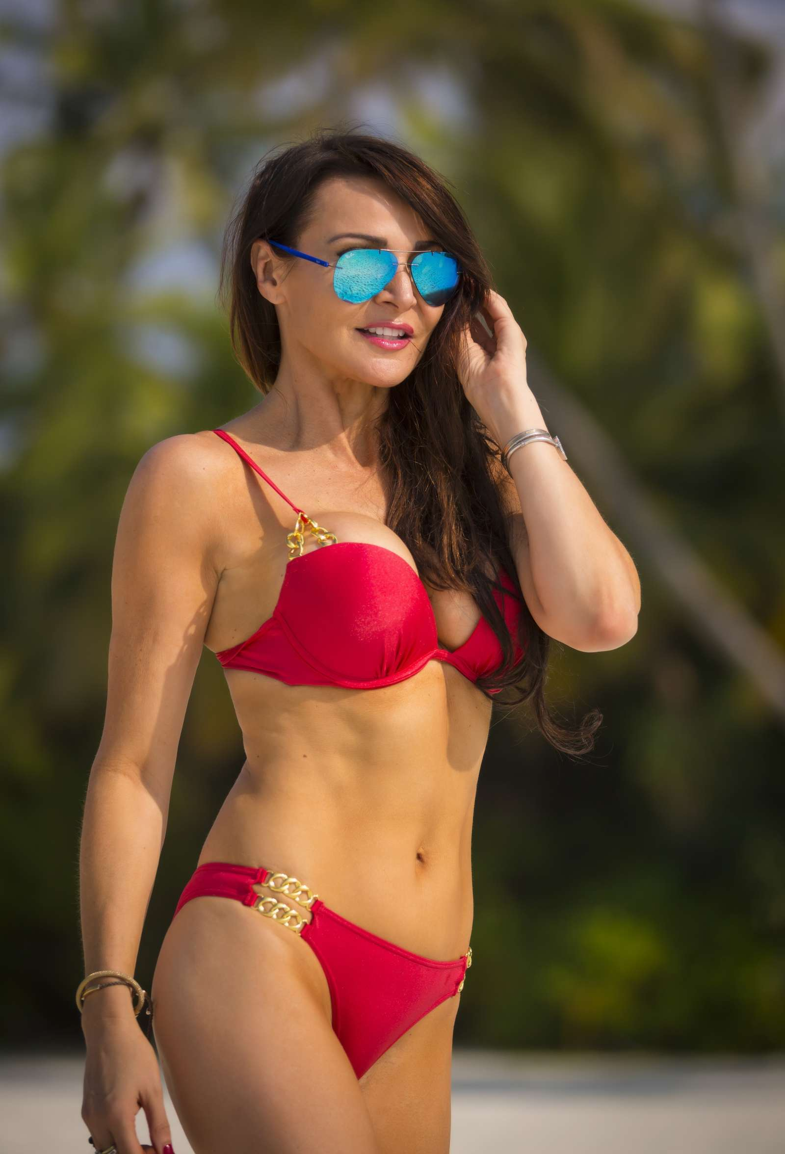 Lizzie Cundy in Red Bikini Celebrates Christmas in The Maldives