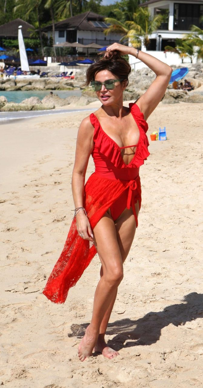 Lizzie Cundy in Red on the beach in Barbados
