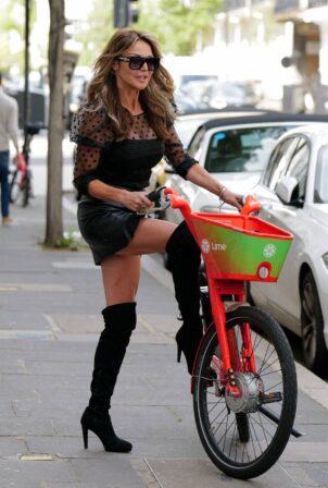 Lizzie Cundy - Seen on electric bike in London
