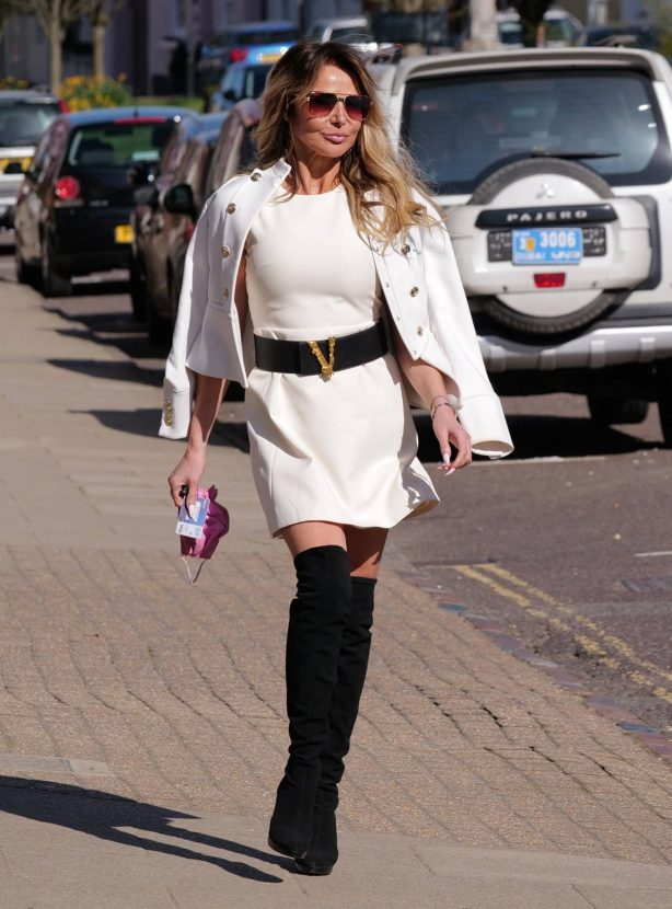 Lizzie Cundy - Wearing knee length boots and a white suit while shopping in London