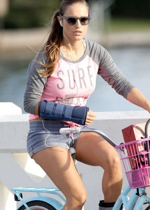 Lola Ponce in Shorts Rides her bike in Miami