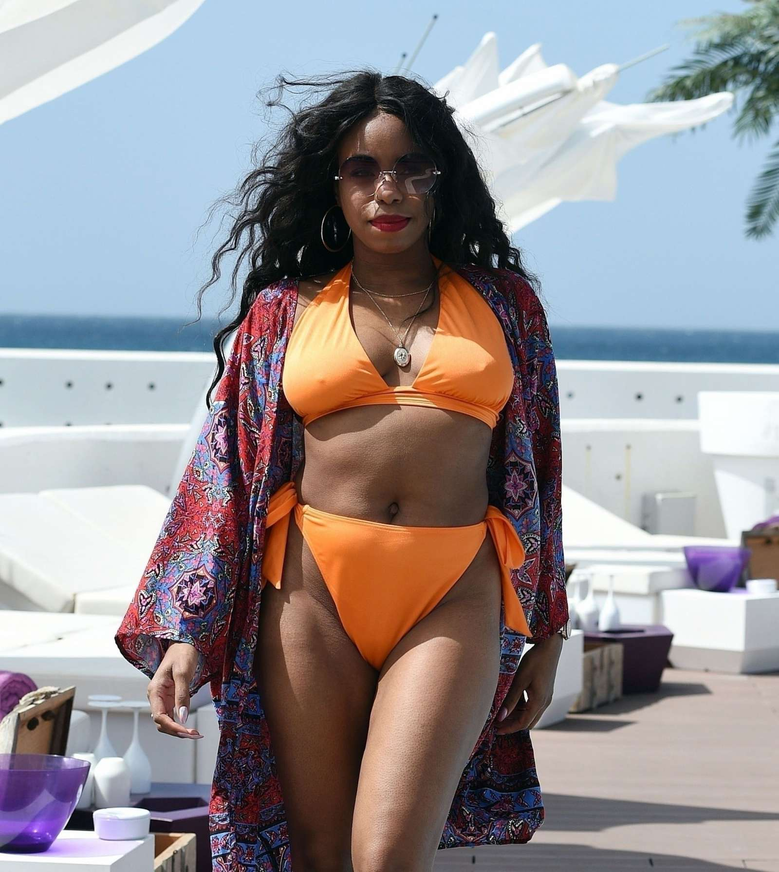 London Hughes in Orange Bikini at a pool party in Cape Verde