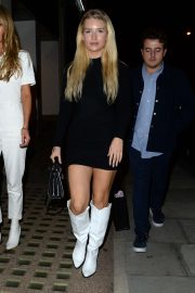 Lottie Moss in Black Mini Dress and White Boots at Harvey Nichols in London