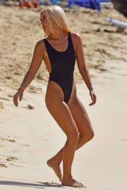 Lottie Tomlinson in Black Swimsuit on the beach in Barbados