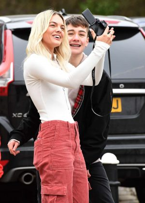 Louisa Johnson with a fan outside Key 103 Radio Station in Manchester