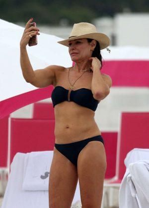 Luann de Lesseps in Black Bikini on the beach in Miami