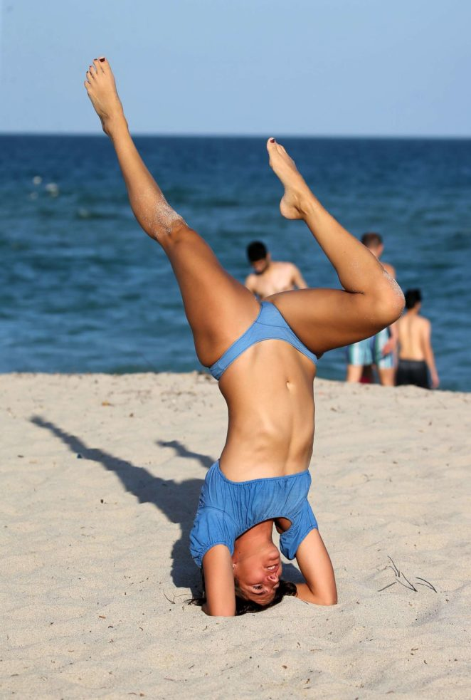 Lucy Aragon in Bikini does yoga on the beach in Miami