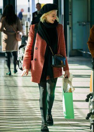 Lucy Boynton at Heathrow Airport in London