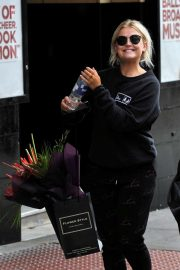 Lucy Fallon - Leaves her hotel in Manchester