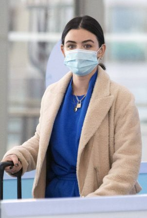 Lucy Hale - Catches a flight out of JFK Airport in New York