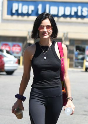 Lucy Hale in black grabbing a coffee in LA