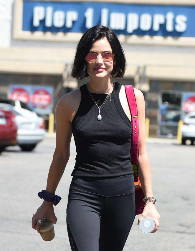 Lucy Hale in black grabbing a coffee in LA