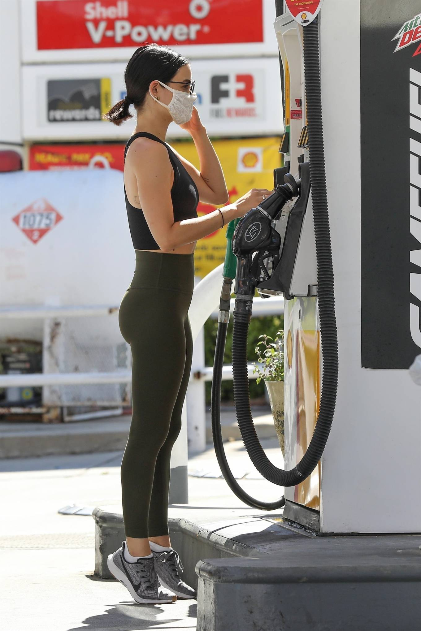 Lucy Hale 2020 : Lucy Hale in Green Tights at a gas station in Studio City-179