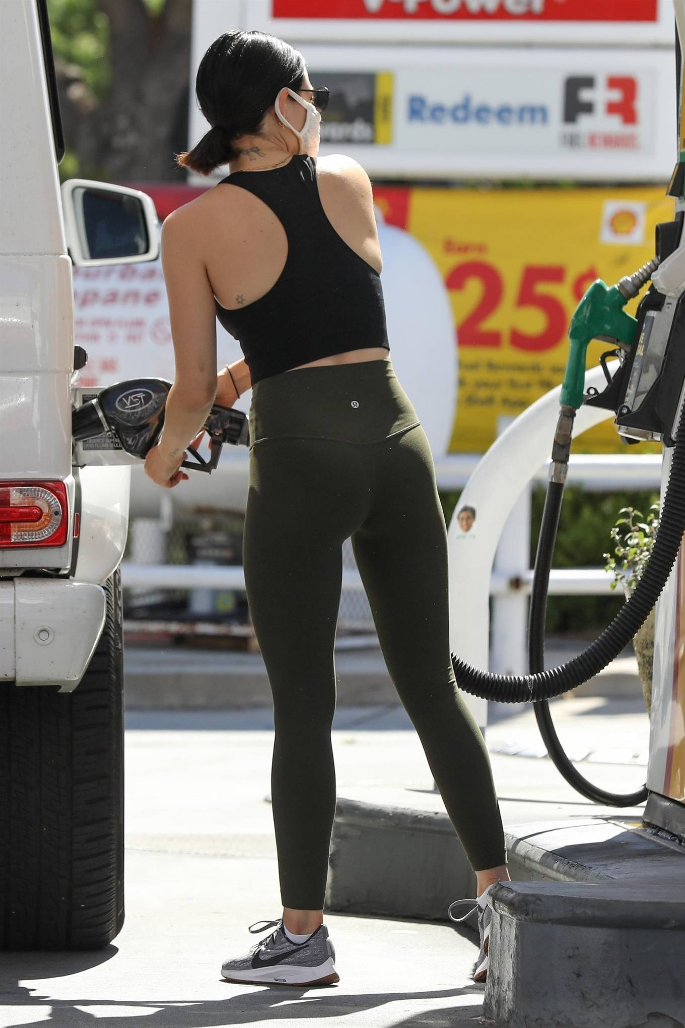 Lucy Hale 2020 : Lucy Hale in Green Tights at a gas station in Studio City-59