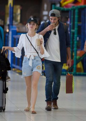 Lucy Hale in Jeans Shorts at Airport in Adelaide