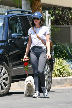 Lucy Hale - In leggings out for a dog walk