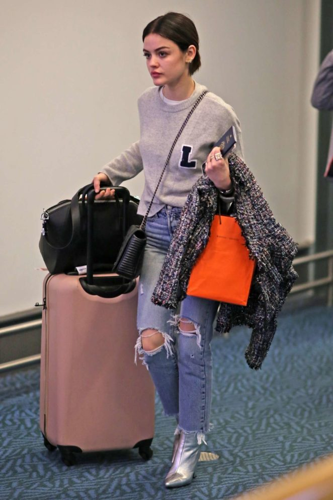 Lucy Hale in Ripped Jeans - Arrives back in Vancouver