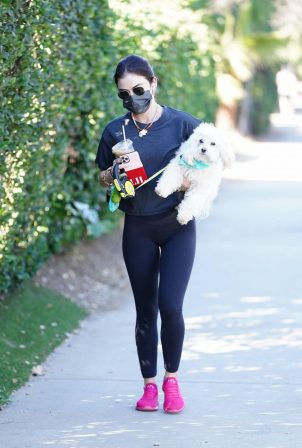 Lucy Hale - out for a hike with Elvis in Los Angeles