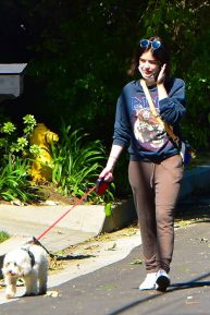 Lucy Hale - Out for a walk with her dog Elvis in Los Angeles