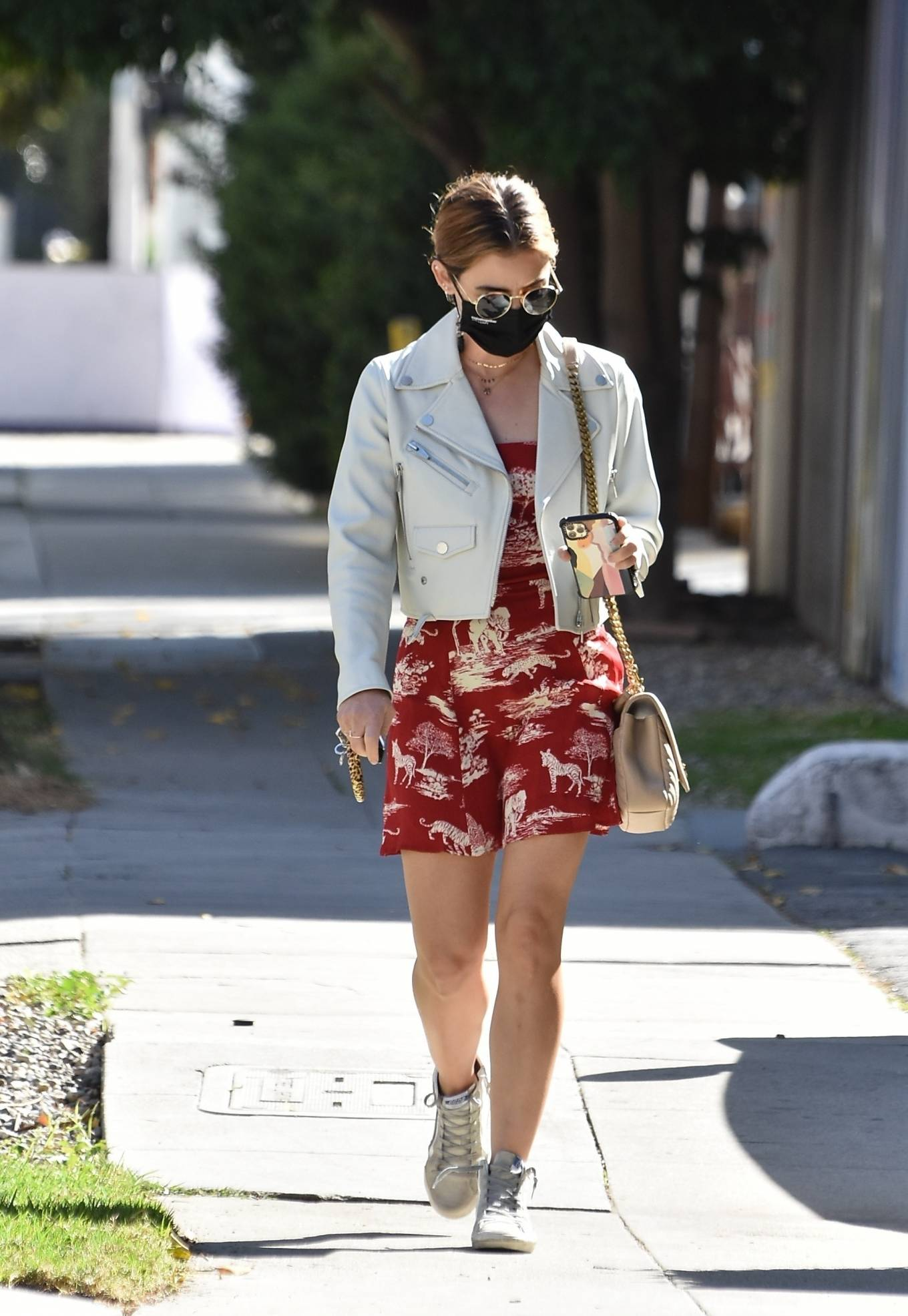 Lucy Hale - Seen in a red dress with a white leather jacket in Los Angeles