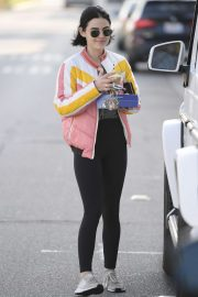 Lucy Hale smiles while on a coffee run after in Los Angeles