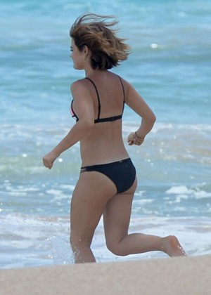 Lucy Hale in Bikini at a beach in Hawaii