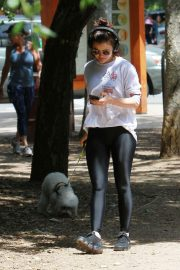 Lucy Hale with her dog goes for a walk at a Los Angeles