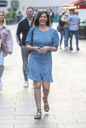 Lucy Horobin - In a blue dress departing her Heart Dance show in London