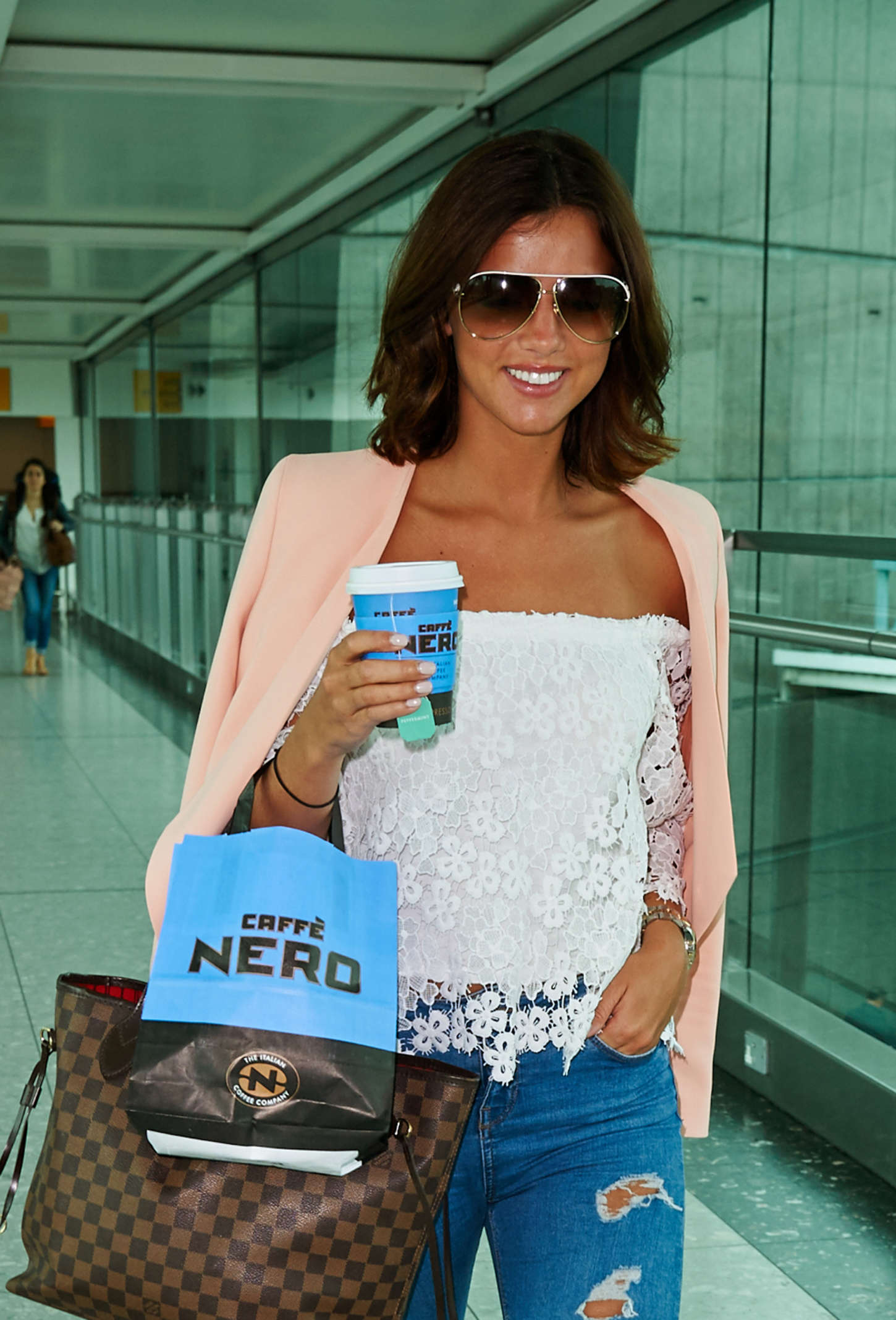 Lucy Mecklenburgh at Heathrow Airport in London