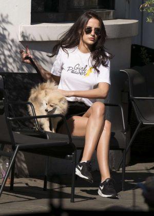 Lucy Watson walks her dog in Chelsea
