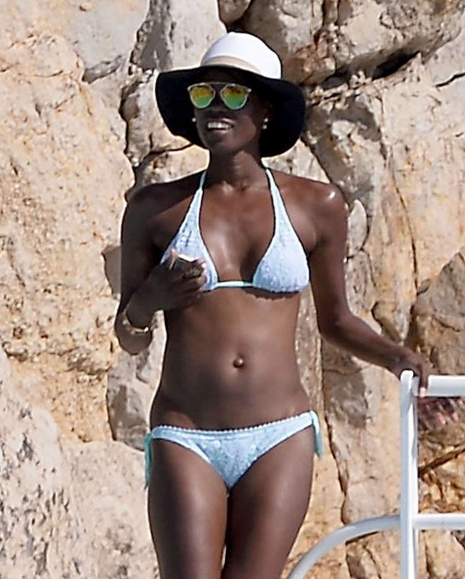 Lupita Nyong'o in White Bikini in Cannes