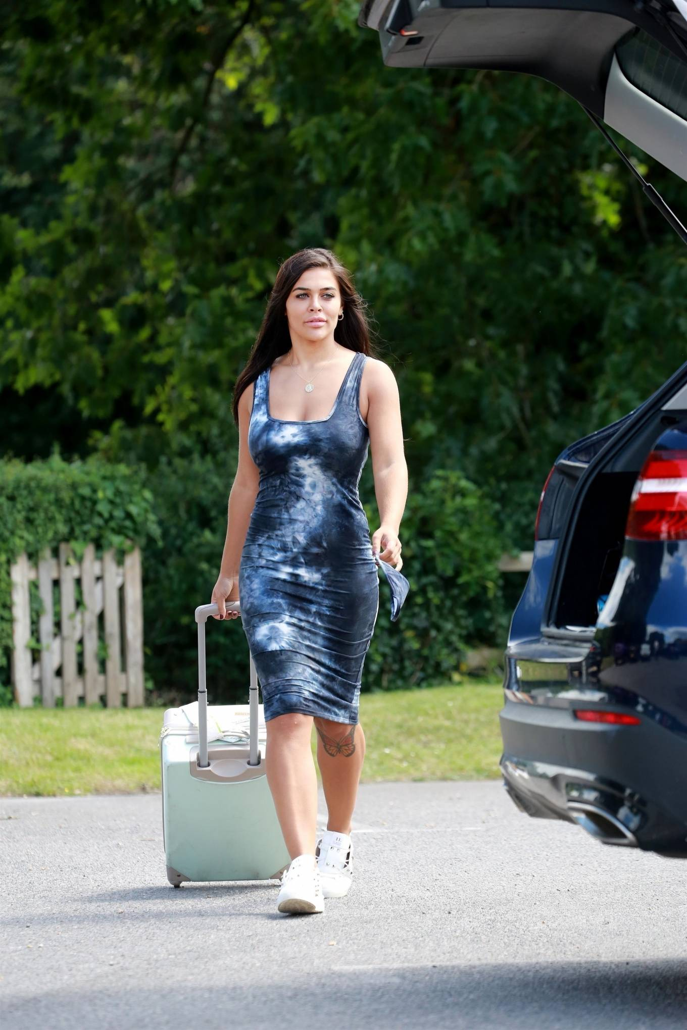 Lydia Clyma in Tight Dress heading off on her holiday after lockdown