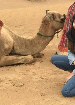 Maddie Ziegler riding a camel in Dubai