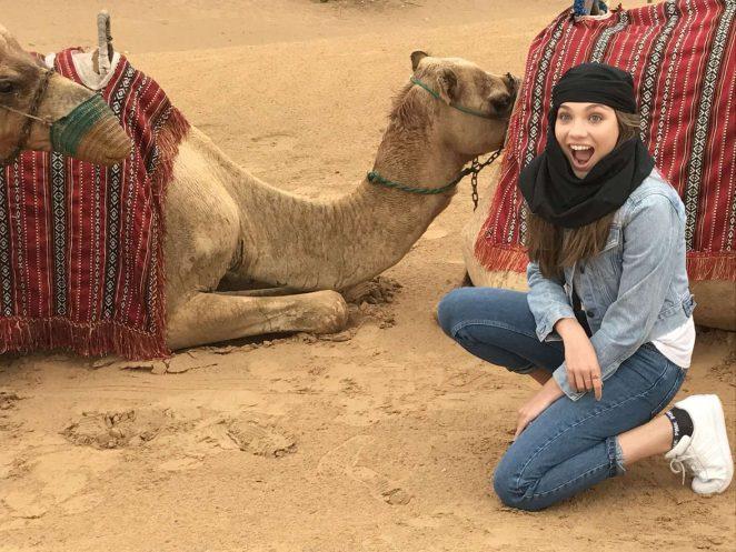 Maddie Ziegler riding a camel in Dubai