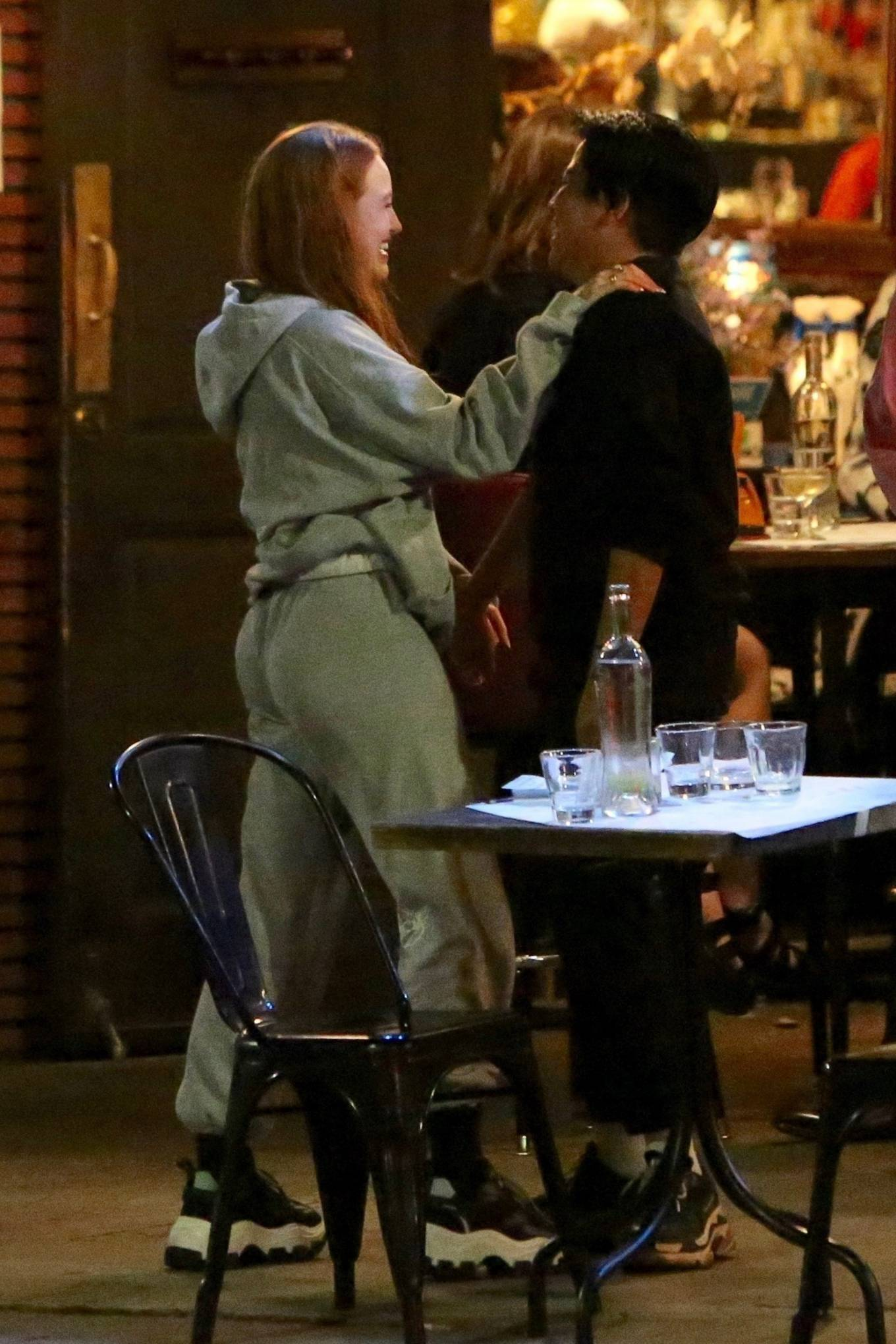 Madelaine Petsch 2020 : Madelaine Petsch is happy to see a friend outside a bar in Los Feliz-01