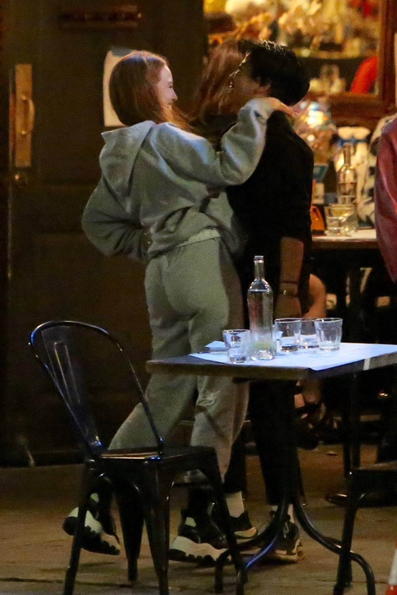 Madelaine Petsch 2020 : Madelaine Petsch is happy to see a friend outside a bar in Los Feliz-03