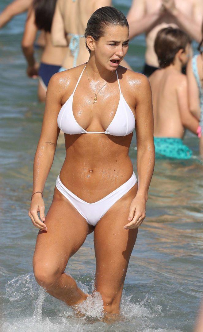 Madi Edwards in White Bikini on a beach in Sydney