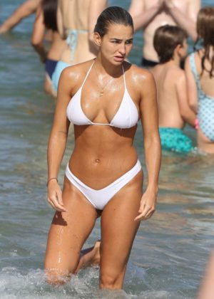 Madi Edwards in White Bikini on a beach in Sydney