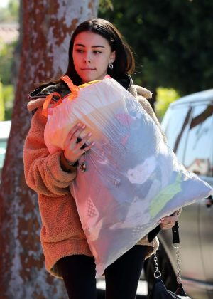 Madison Beer - Gives a big bag of clothes away to charity in LA
